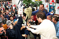 Montreal, June 5th 2001<br /> <br /> BAR team Formula One driver, JACQUES VILLENEUVE sign autographs for fans, June 5th 2001,  in front of his new restaurant - dance club ``Newtown `` on Crescent Street in downtown MONTREAL , Canada.<br /> Photo by Pierre Roussel / Getty Images (On spec.)<br /> NOTE : Nikon D-1 TIFF open with QImage ICC profile, save in Adobe 1998 RGB color space.