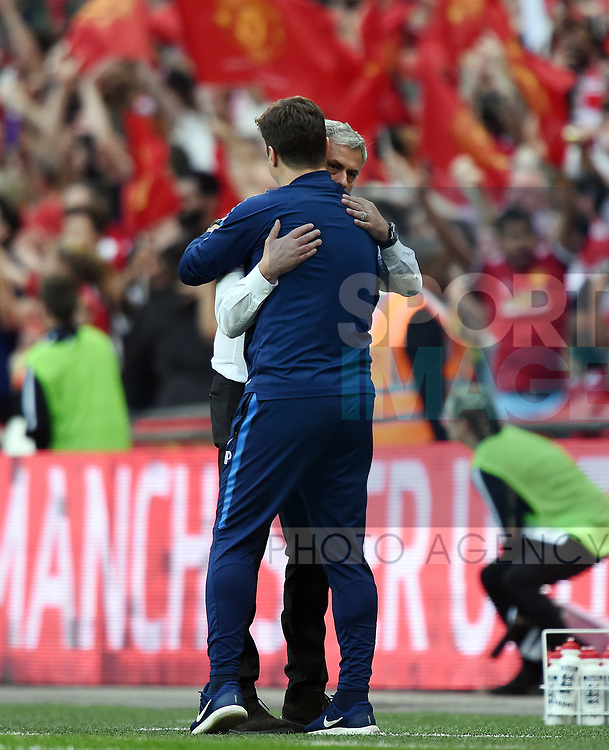 Manchester United Manager Jose Mourinho hugs Tottenham Hotspur Manager Mauricio Pochettino at the end of the FA cup semi-final match at Wembley Stadium, London. Picture date 21st April, 2018. Picture credit should read: Robin Parker/Sportimage