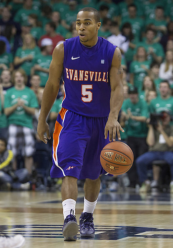 November 10, 2012:  Evansville guard Troy Taylor (5) dribbles the ball during NCAA Basketball game action between the Notre Dame Fighting Irish and the Evansville Purple Aces at Purcell Pavilion at the Joyce Center in South Bend, Indiana.  Notre Dame defeated Evansville 58-49.