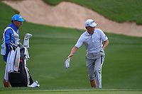Matt Jones (AUS) takes his shoes and socks off to hit from the water near the green on 18 during day 3 of the Valero Texas Open, at the TPC San Antonio Oaks Course, San Antonio, Texas, USA. 4/6/2019.<br /> Picture: Golffile | Ken Murray<br /> <br /> <br /> All photo usage must carry mandatory copyright credit (&copy; Golffile | Ken Murray)