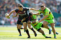 Alex Goode of Saracens offloads the ball after being tackled by Luther Burrell of Northampton Saints. Aviva Premiership match, between Saracens and Northampton Saints on September 2, 2017 at Twickenham Stadium in London, England. Photo by: Patrick Khachfe / JMP