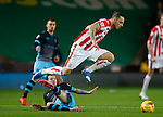 Marko Arnautovic of Stoke City leaps over Ross Wallace of Sheffield Wednesday - Capital One Cup Quarter-Final - Stoke City vs Sheffield Wednesday - Britannia Stadium - Stoke - England - 1st December 2015 - Picture Simon Bellis/Sportimage