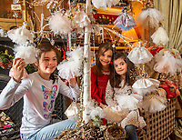 BNPS.co.uk (01202 558833)<br /> Pic: PhilYeomans/BNPS<br /> <br /> Dinah's granddaughter's Franka(l-9), Carla(7) and Daisy(5) lend a hand...<br /> <br /> Fairy Grandmother - Bespoke fairy maker Dinah Nicholson gets a helping hand from grandchildren Franka, Carla and Daisy this Christmas...<br /> <br /> Described as a 'Living National Treasure' by Country Life magazine her unique creations have even been supplied as wedding gifts for the bridesmaids at Royal weddings.<br /> <br /> Each of her 4159 creations so far have been logged in a fairy ledger, and the £60 cost has never been increased as 'I want everyone to be able to afford one'.
