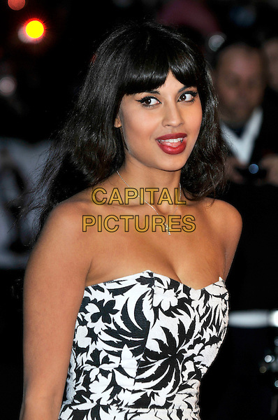 "JAMEELA JAMIL.""17 Again"" UK film premiere at the Odeon West End cinema, London, England, UK, .26th March 2009..arrivals half length black and white print strapless dress headshot red lipstick eyeliner make-up fringe silver cross necklace .CAP/PL.©Phil Loftus/Capital Pictures"