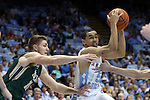 30 December 2014: North Carolina's Marcus Paige (5) and William and Mary's Michael Schlotman (11). The University of North Carolina Tar Heels played the College of William & Mary Tribe in an NCAA Division I Men's basketball game at the Dean E. Smith Center in Chapel Hill, North Carolina. UNC won the game 86-64.