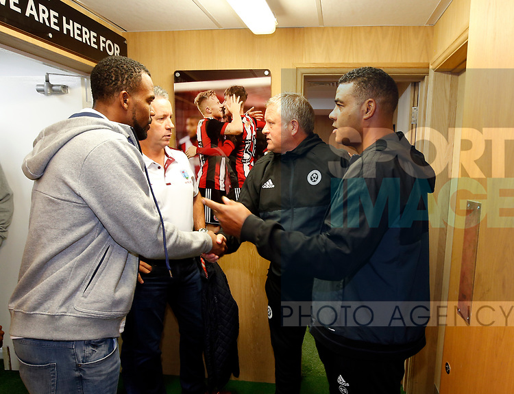 Chris Wilder manager of Sheffield Utd meets the West Indian cricket team during the Carabao Cup, second round match at Bramall Lane, Sheffield. Picture date 22nd August 2017. Picture credit should read: Simon Bellis/Sportimage