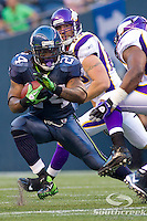 Seattle Seahawks running back Marshawn Lynch (24) runs upfield in a game against the Minnesota Vikings at CenturyLink Field in Seattle, Washington.