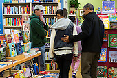 "United States President Barack Obama, right, and daughter Malia, left, shop at One More Page Books in Arlington, Virginia on Small Business Saturday, November 24, 2012. .Credit: Kristoffer Tripplaar  / Pool via CNP..Pool Report 1: Motorcade left the South Lawn [of the White House] at 1:02 p.m. and arrived in Arlington, Virginia, at One More Page Books at 1:15 p.m. for an OTR (Off the Record) Small Business Saturday event with Sasha and Malia.  From the door of the small book shop, which the White House described as an ""independent, neighborhood bookstore,"" POTUS (President of the United States) could be seen holding up his BlackBerry, apparently looking up a title, as he spoke with shop owner Eileen McGervey. ""Preparation,"" the president said. ""That's how I shop.""  Wearing a dark windbreaker against the blustery weather outside, POTUS handed off a stack of about 10 books to the clerk -- pool was too far away to read titles -- (will send in a later report if we get them) and then shook hands with several employees. He then began to wander through the business with his daughters as pool was escorted out.  ""We're doing Christmas shopping,"" POTUS said to a question from the pool about the fiscal cliff. ""Happy Thanksgiving, folks.""  POTUS emerged about 10 minutes later to shake hands for a few minutes with two small groups that formed outside the shop on the sidewalk."