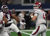 NWA Democrat-Gazette/J.T. WAMPLER Arkansas' Ty Storey looks for a receiver whileTexas A&M's Kingsley Keke closes in Saturday Sept. 29, 2018 at AT&T Stadium in Arlington. The Aggies beat the Razorbacks 24-17.