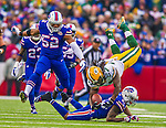 14 December 2014: Green Bay Packers running back Eddie Lacy dives to cap a 15-yard gain in the first quarter against the Buffalo Bills at Ralph Wilson Stadium in Orchard Park, NY. The Bills defeated the Packers 21-13, snapping the Packers' 5-game winning streak and keeping the Bills' 2014 playoff hopes alive. Mandatory Credit: Ed Wolfstein Photo *** RAW (NEF) Image File Available ***