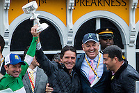 BALTIMORE, MD - MAY 21: Exaggerator jockey Kent J. Desormeaux (L) and trainer Keith Desormeaux (C) hold the trophy next to owner Matt Bryan after winning the 141st running of the Preakness Stakes at Pimlico Race Course on May 21, 2016 in Baltimore, Maryland. (Photo by Sue Kawczynski/Eclipse Sportswire/Getty Images)