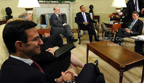 United States President Barack Obama speaks to the media after meeting with Federal Reserve Board Chairman Ben Bernanke (LC) in the Oval Office of the White House in Washington on Tuesday, June 29, 2010. With them are outgoing Office of Management and Budget Director Peter R. Orszag (L) and Treasury Secretary Timothy Geithner (R).  .Credit: Roger L. Wollenberg - Pool via CNP