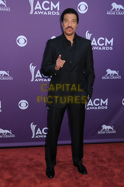 Lionel Richie.47th Annual Academy of Country Music Awards held at the MGM Grand, Las Vegas, Nevada, USA..April 1st, 2012.full length black suit hand finger pointing  ACM CMA.CAP/ADM/BP.©Byron Purvis/AdMedia/Capital Pictures.