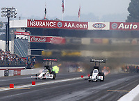 Nov 12, 2017; Pomona, CA, USA; NHRA top fuel driver Steve Torrence (left) races alongside Antron Brown during the Auto Club Finals at Auto Club Raceway at Pomona. Mandatory Credit: Mark J. Rebilas-USA TODAY Sports