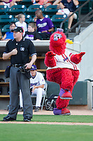 Winston-Salem Dash mascot Bolt tries to sneak up on home plate umpire Mike Provine between innings of the Carolina League game against the Frederick Keys at BB&T Ballpark on July 29, 2014 in Winston-Salem, North Carolina.  The Dash defeated the Keys 4-0.   (Brian Westerholt/Four Seam Images)