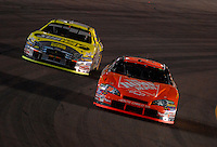 Apr 22, 2006; Phoenix, AZ, USA; Nascar Nextel Cup driver Tony Stewart of the (20) Home Depot Chevrolet Monte Carlo leads Greg Biffle during the Subway Fresh 500 at Phoenix International Raceway. Mandatory Credit: Mark J. Rebilas-US PRESSWIRE Copyright © 2006 Mark J. Rebilas..