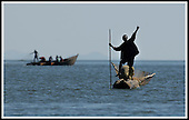 Malawi - a fisherman, in his Bwato (dug-out) canoe on Lake Malombe, in southern Malawi .... Pic Donald MacLeod 29.05.05