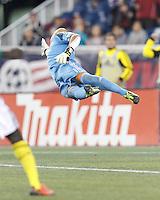 New England Revolution goalkeeper Matt Reis (1) dive. In a Major League Soccer (MLS) match, the New England Revolution (blue) defeated Columbus Crew (white), 3-2, at Gillette Stadium on October 19, 2013.