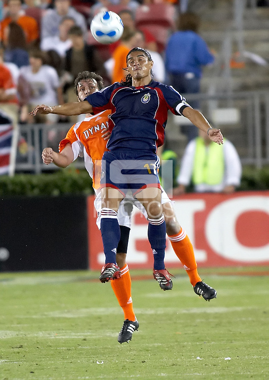 Chivas USA forward Juan Francisco Palencia (17) gets a head on the ball over Houston Dynamo defender Eddie Robinson (2).  Houston Dynamo beat CD Chivas USA 2-0 at Robertson Stadium in Houston, TX on October 29, 2006 to gain a berth in the Western Conference Final on a 3-2 aggregate.
