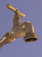 Water dripping from tap