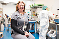 Brooke Charron is Director of Human Resources at Garden Remedies, a medical cannabis producer, at the Garden Remedies growing and production facility in Fitchburg, Massachusetts, USA, on Fri., Feb. 22, 2019. She is seen here in the topicals and formulations room where, at right, a worker is making cannabis-infused lotion and lip balm.