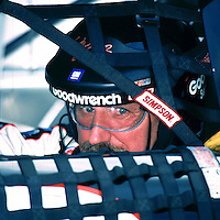 NASCAR driver Dale Earnhardt peers out of his race car as he waits to qualify at Darlington, SC on Friday 9/1/00. (Photo by Brian Cleary/www.bcpix.com)
