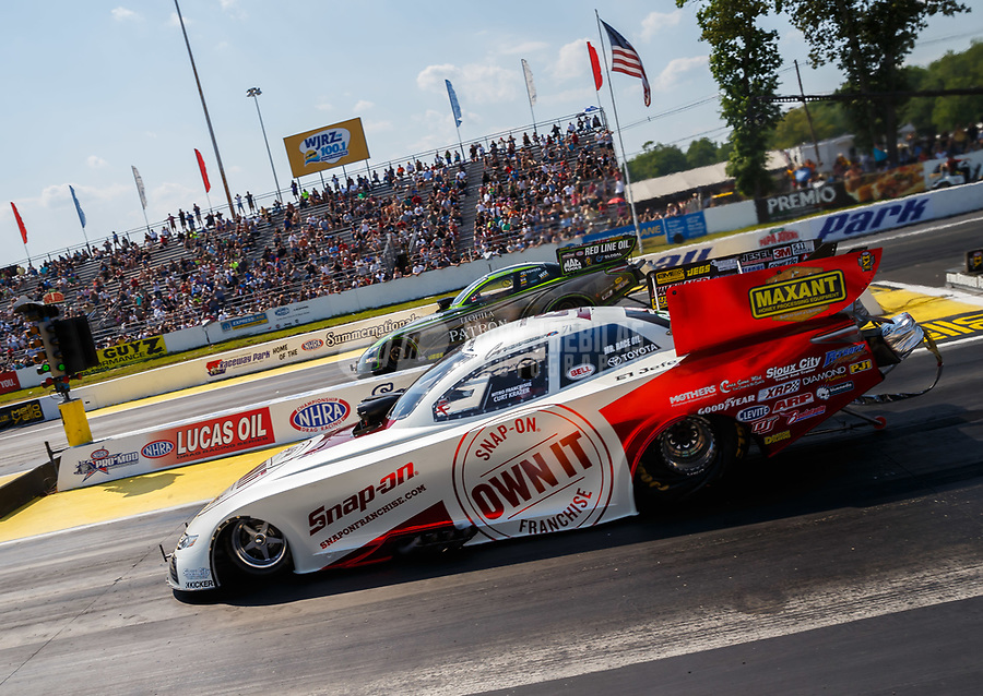 Jun 10, 2017; Englishtown , NJ, USA; NHRA funny car driver Cruz Pedregon (right) races alongside Alexis DeJoria during qualifying for the Summernationals at Old Bridge Township Raceway Park. Mandatory Credit: Mark J. Rebilas-USA TODAY Sports