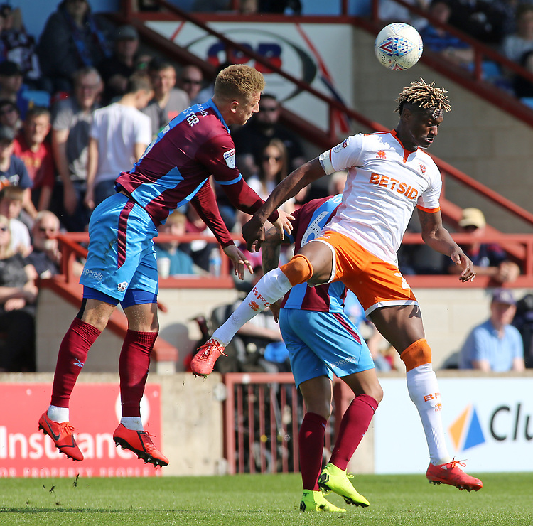 Scunthorpe United's Byron Webster battles with Blackpool's Armand Gnanduillet<br /> <br /> Photographer David Shipman/CameraSport<br /> <br /> The EFL Sky Bet League One - Scunthorpe United v Blackpool - Friday 19th April 2019 - Glanford Park - Scunthorpe<br /> <br /> World Copyright © 2019 CameraSport. All rights reserved. 43 Linden Ave. Countesthorpe. Leicester. England. LE8 5PG - Tel: +44 (0) 116 277 4147 - admin@camerasport.com - www.camerasport.com
