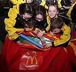 Ciara Butterly, Aoibheanna Campbell, Ronan Kelly and Mark Byrnes of Dunleer Athletics Club inspect the McDonald's Little Athletic Packs presented to them at McDonalds, Drogheda as part of a Nationwide Programme which is encouraging and providing the resources for children to become involved in grassroots athletics...Photo NEWSFILE/Jenny Matthews.(Photo credit should read Jenny Matthews/NEWSFILE)....This Picture has been sent you under the condtions enclosed by:.Newsfile Ltd..The Studio,.Millmount Abbey,.Drogheda,.Co Meath..Ireland..Tel: +353(0)41-9871240.Fax: +353(0)41-9871260.GSM: +353(0)86-2500958.email: pictures@newsfile.ie.www.newsfile.ie.FTP: 193.120.102.198.