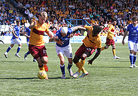 Scott Mercer dispossessed by James Scott (left) and Devante Cole in the SPFL Betfred League Cup group match between Queen of the South and Motherwell at Palmerston Park, Dumfries on 13.7.19.