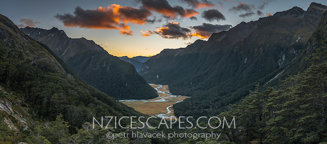 Sun rises above Routeburn Flats, seen from near Routeburn Falls hut, Mt. Aspiring National Park, Central Otago, New Zealand