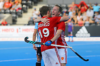 David Goodfield celebrates with Barry Middleton after scoring England's 3rd goal during the Hockey World League Semi-Final match between England and Argentina at the Olympic Park, London, England on 18 June 2017. Photo by Steve McCarthy.