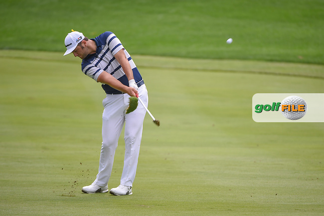 Jon Rahm (ESP) hits his approach shot on 16 during 1st round of the World Golf Championships - Bridgestone Invitational, at the Firestone Country Club, Akron, Ohio. 8/2/2018.<br /> Picture: Golffile | Ken Murray<br /> <br /> <br /> All photo usage must carry mandatory copyright credit (© Golffile | Ken Murray)