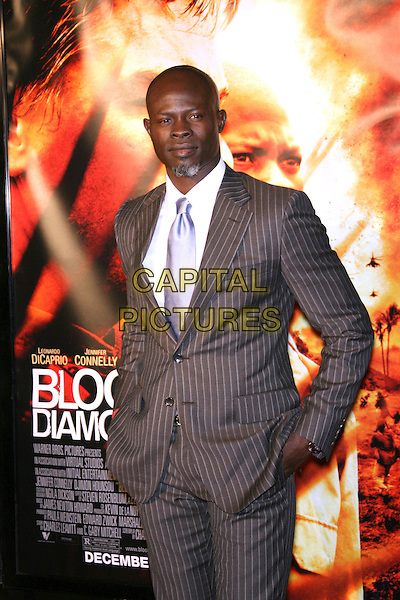 "DJIMON HOUNSOU.""Blood Diamond"" Premiere - Arrivals presented by Warner Brothers in association with Virtual Studios held at the Grauman's Chinese Theater, Hollywood, California, USA..December 6th, 2006.half length wearing Gucci grey gray suit jacket pinstripe.CAP/ADM/ZL.©Zach Lipp/AdMedia/Capital Pictures"