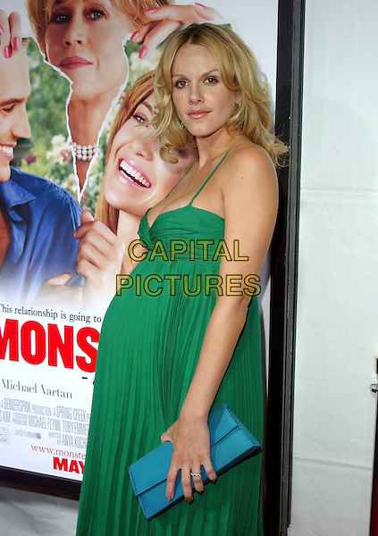 "MONET MAZUR.At New Line Cinema's Los Angeles Premiere of ""Monster-in-Law"" held at The Mann National Theatre in Westwood, California, USA,.half length pregnant green dress turquoise clutch bag.Ref: DVS.www.capitalpictures.com.sales@capitalpictures.com.©Debbie VanStory/Capital Pictures"