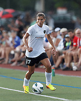 Portland Thorns FC midfielder Tobin Heath (17) dribbles down the wing. In a National Women's Soccer League (NWSL) match, Portland Thorns FC (white/black) defeated Boston Breakers (blue), 2-1, at Dilboy Stadium on July 21, 2013.