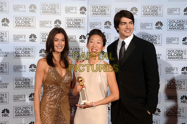 TERI HATCHER, SANDRA OH & BRANDON ROUTH.63rd Annual Golden Globe Awards - Arrivals held at the Beverly Hills Hilton, Beverly Hills, California, USA..Winner of Best Supporting Actress in a Series, Mini-Series or Motion Picture made for Television.January 16th, 2006.Ref: AW.globes half length white dress award trophy brown sequins black.www.capitalpictures.com.sales@capitalpictures.com.Supplied By Capital Pictures.