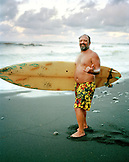 USA, Hawaii, The Big Island, portrait of a surfer giving a hang loose at Honoli'i Beach North of the town of Hilo