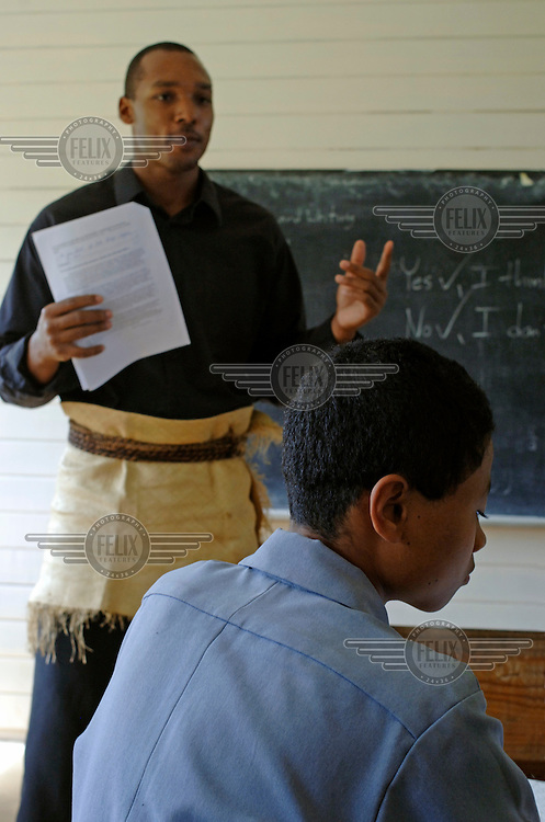 Ryan Smith, an American Peace Corp teacher, engages pupils in a classroom at Tonga High School.
