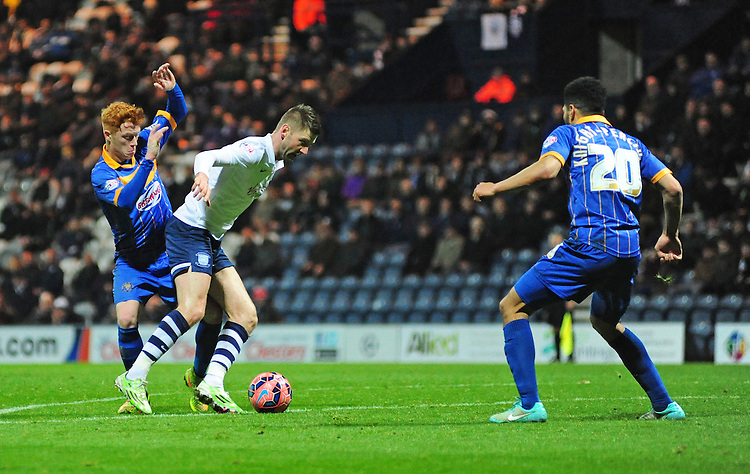 Preston North End's Paul Gallagher shields the ball from Shrewsbury Town's Ryan Woods<br /> <br /> Photographer Chris Vaughan/CameraSport<br /> <br /> Football - FA Challenge Cup Second Round - Preston North End v Shrewsbury Town - Saturday 6th December 2014 - Deepdale - Preston<br /> <br />  &copy; CameraSport - 43 Linden Ave. Countesthorpe. Leicester. England. LE8 5PG - Tel: +44 (0) 116 277 4147 - admin@camerasport.com - www.camerasport.com