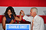 MIAMI, FL - OCTOBER 17: U.S. First Lady Michelle Obama and stands with former Florida Governor and now Democratic gubernatorial candidate Charlie Crist as she campaigns for him during an event at the Betty T. Ferguson Recreational Complex Gymnasium on Friday October 17, 2014 in Miami, Florida. Crist is facing off against incumbent Republican Governor Rick Scott in the November 4, 2014 election. (Photo by Johnny Louis/jlnphotography.com)