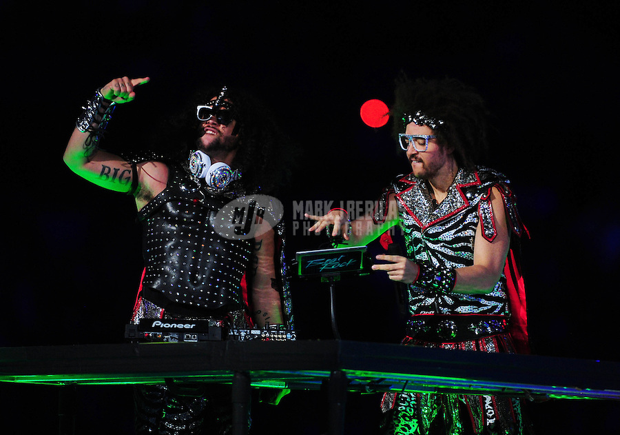 Feb 5, 2012; Indianapolis, IN, USA; Recording artists SkyBlu (left) and RedFoo (right) of LMFAO perform with Madonna (not pictured) during the halftime show for Super Bowl XLVI between the New York Giants and New England Patriots at Lucas Oil Stadium.  Mandatory Credit: Mark J. Rebilas-.