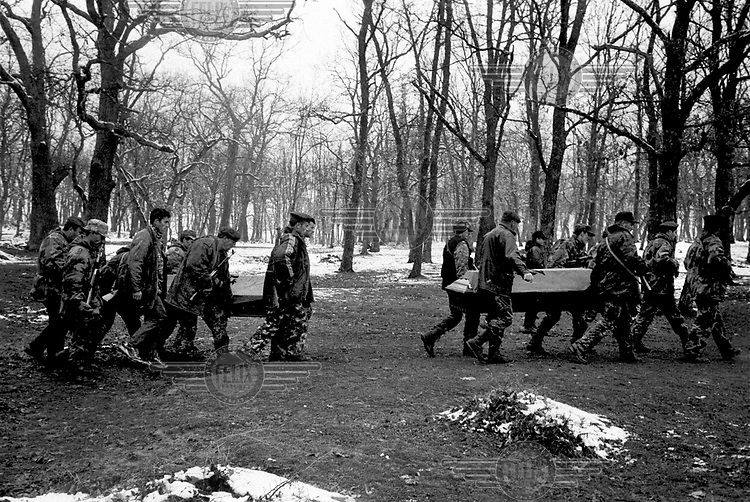 KLA soldiers carry the coffins of their dead comrades at a funeral in Domanik, near Malisevo.