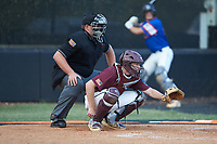 Kannapolis Post 115 catcher Austin Dayvault (11) sets a target as the home plate umpire looks on during an American Legion baseball game against Mooresville Post 66 at Northwest Cabarrus High School on May 30, 2019 in Concord, North Carolina. Mooresville Post 66 defeated Kannapolis Post 115 4-3. (Brian Westerholt/Four Seam Images)