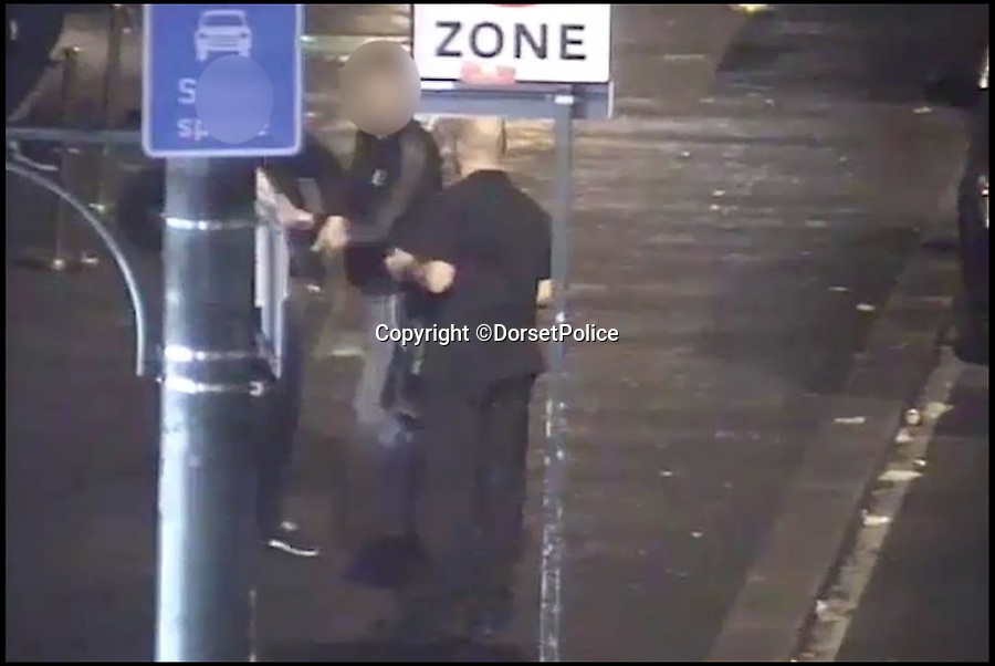 BNPS.co.uk (01202 558833)Pic: DorsetPolice/BNPS<br /> <br /> A screenshot of CCTV footage showing Kevin Boyle and two bystanders. The two bystanders intervene with the initial incident between Kevin Boyle and the two bouncers at the Camel Club.(4:15am on Friday 18th August 2017).<br /> <br /> AA knife maniac who nearly killed an innocent bystander he mistook for someone he had a row with because both men had ginger hair was today jailed for 21 years.<br /> <br /> Kevin Boyle waited outside a Bournemouth nightclub for the red-headed reveller who had shoved him two hours earlier to appear.<br /> <br /> When clubber Glen Morrant walked out Boyle began to follow him by mistake because he was wearing similar clothes to the first man and also had ginger hair.<br /> <br /> Boyle slashed the 19-year-old by the throat. He was sentenced today at Winchester Crown Court.