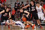 RAPID CITY, S.D. MARCH 20, 2015 -- Brendan Harter #52 of Winner dives as Ty Hoglund #24 of Dell Rapids reaches for a loose ball during their semi-final game at the 2015 South Dakota State A Boys Basketball Tournament at the Don Barnett Arena in Rapid City, S.D.  In the background are Adam Karst #20 and Ben Hammer #44 of Dell Rapids and Nathan Galbraith #22 of Winner.  (Photo by Dick Carlson/Inertia)
