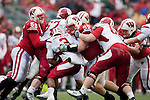 Wisconsin Badgers defensive linemen Beau Allen (96) and Eriks Briedis (55) tackle Indiana Hoosiers running back Zach Davis-Walker (3) during an NCAA college football game on November 13, 2010 at Camp Randall Stadium in Madison, Wisconsin. The Badgers won 83-20. (Photo by David Stluka)