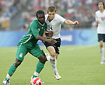 13 August 2008: Chibuzor Okonkwo (NGA) (2) and Robbie Rogers (USA) (14) challenge for the ball.  The men's Olympic team of Nigeria defeated the men's Olympic soccer team of the United States 2-1 at Beijing Workers' Stadium in Beijing, China in a Group B round-robin match in the Men's Olympic Football competition.