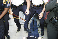 A young man is arrested at the New York Public Library in New York City on August 31, 2004 during the Republican National Convention.  The library steps were a meeting point for a group calling itself the A31 Action Coalition which called for civil disobedience on a mass scale that day.  The library steps quickly cleared as police began arresting people, sometimes indiscriminately.