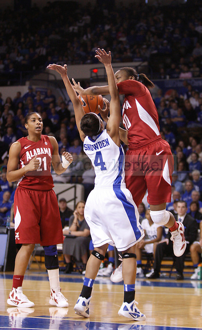 UK guard Keyla Snowden attempts to block Meghan Perkins shot during the first half of the UK Women's basketball game against Alabama on 1/29/12 at Memorial Coliseum in Lexington, Ky. Photo by Quianna Lige | Staff